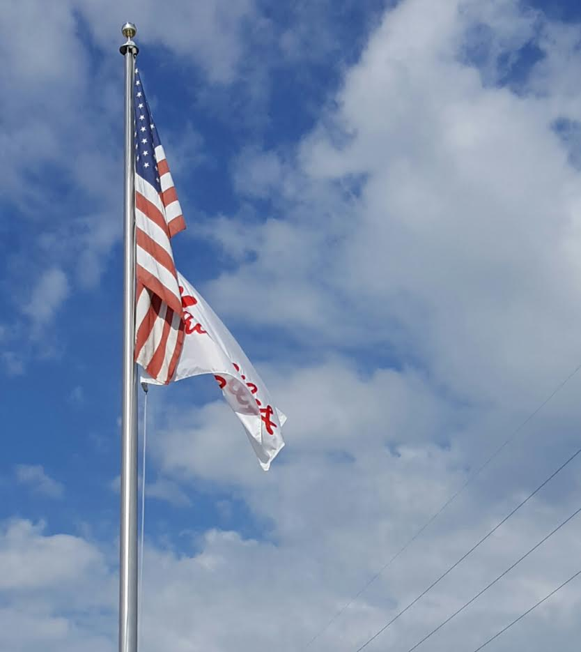 69b8d49484a Chick Fil A and U-Haul flags flying from the same staff as the U.S. Flag