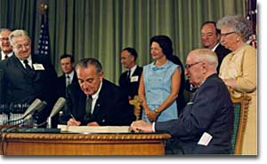 President Lyndon Johnson signing the Medicare program into law